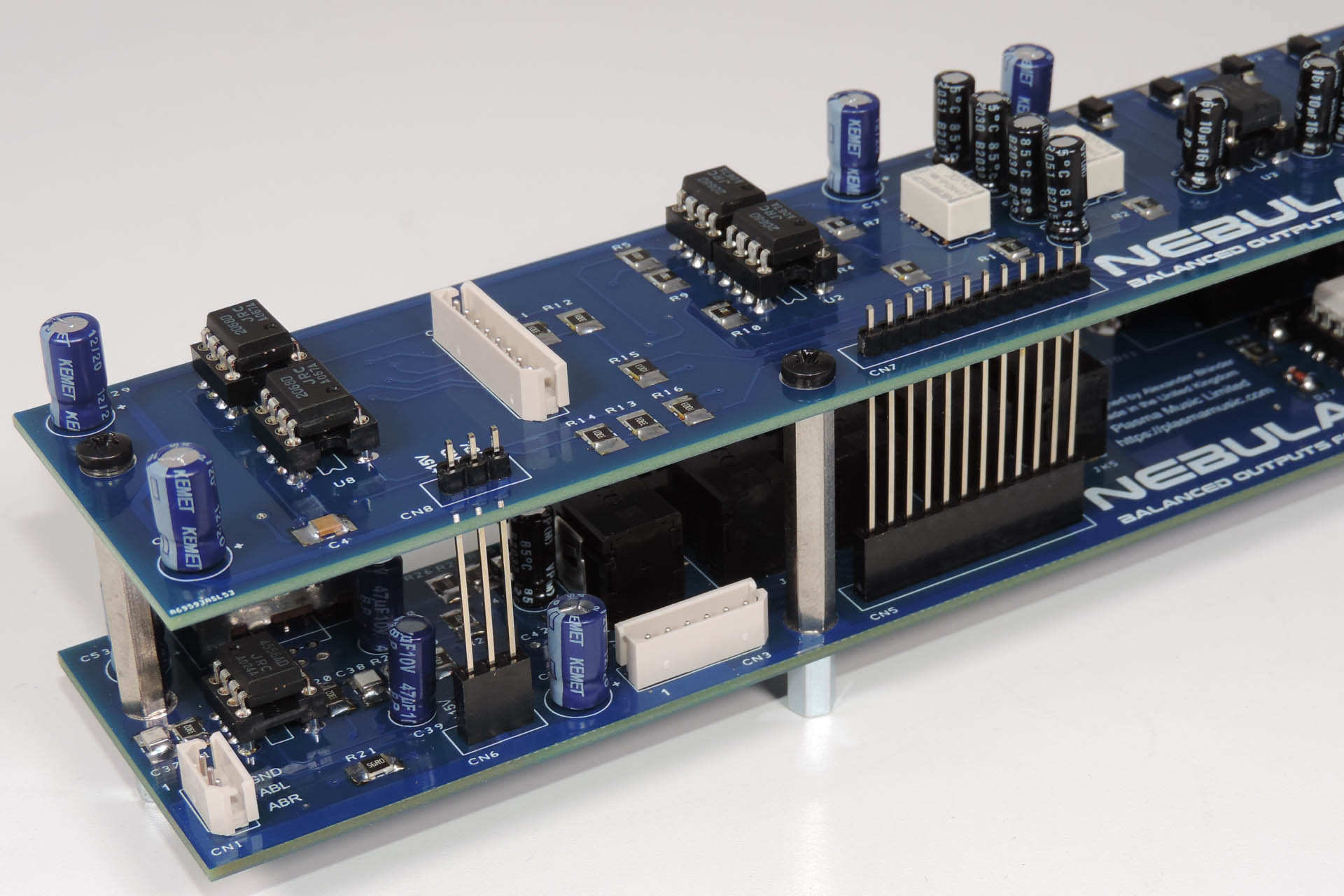 Nebula balanced outputs for the Roland MKS-70 inter-board connectors are solder with boards assembled for perfect alignment